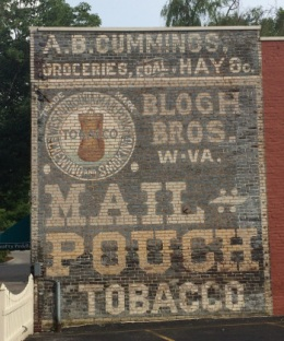 """A. B. Cummings store is now more widely known as """"the Mail Pouch building."""" It was originally painted between 1892 - 1897 and was repainted in 1994."""