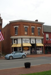 """This building, now known as the """"Lollipop Shop,"""" was built in 1905 by the Rhea Lodge # 47, Free and Accepted Masons."""