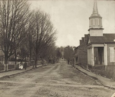 Looking east on Main Street, Jonesborough, circa 1890. On the right is the Methodist Church, built in 1845 and Sisters Row, built around 1820 by Samuel Jackson.