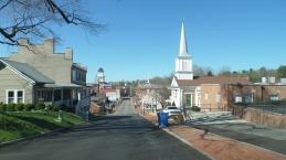 Looking west on Main Street, the Baptist Church is on the right and the courthouse clock tower can be seen on the left.