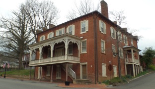 "Built by John W. Simpson around 1843, this was originally called the ""John Simpson Hotel."" In 1853, Simpson advertised that he had a buggy for sale and asked interested persons to call on him at the ""mansion House."" The building is still more commonly known as the ""Mansion House."""