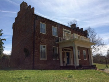 The Rhea - Hoss House was built in 1857 by Dr. Thomas Rhea. Late in 1865, Dr. Rhea moved his family to Kentucky and the home was sold to another physician, Dr. Henry Hoss.