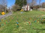 A local resident has marked the number of Covid 19 deaths within the county with flags.